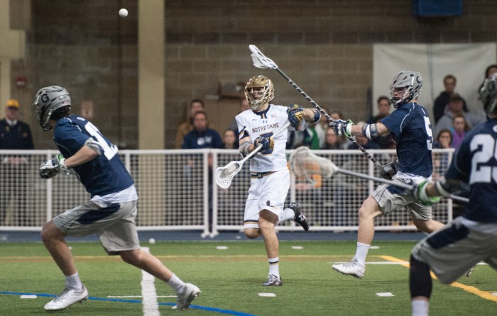 Graduate student Jim Marlatt fires a pass against Georgetown on Feb. 14. The Irish are undefeated in the ACC at 3-0.