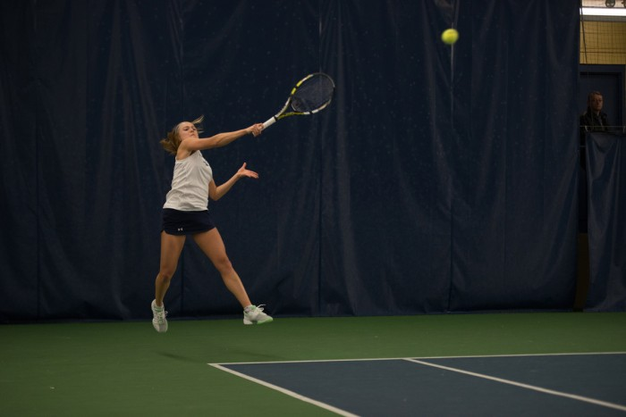 Irish sophomore Monica Robinson hits a forehand during Notre Dame's 6-1 loss to Stanford on Feb. 6 at Eck Tennis Pavilion.