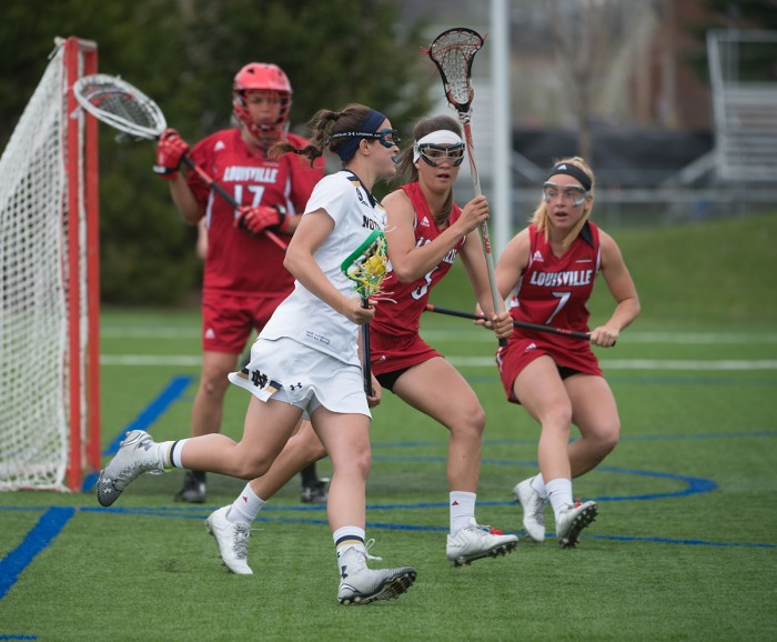 Sophomore attack Courtney Fortunato cradles the ball in Sunday's 10-8 loss to Louisville. Fortunato had four goals in the defeat.