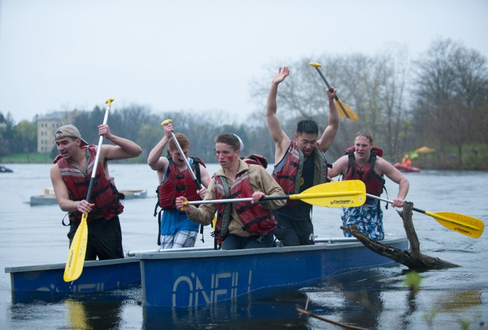 Residents of O'Neil Hall paddle their handmade boat for the 25th annual Fisher Regatta.
