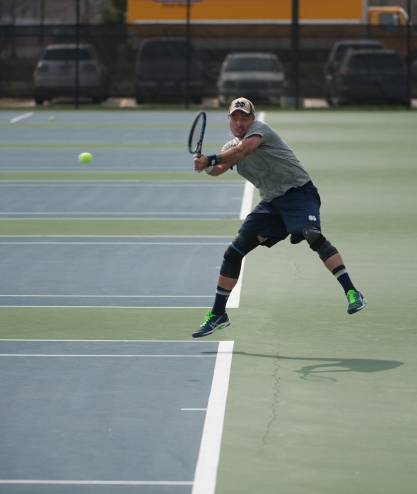 Senior Billy Pecor hits a backhand during Notre Dame's 4-3 victory against North Carolina State on April 18 at Courtney Tennis Center.