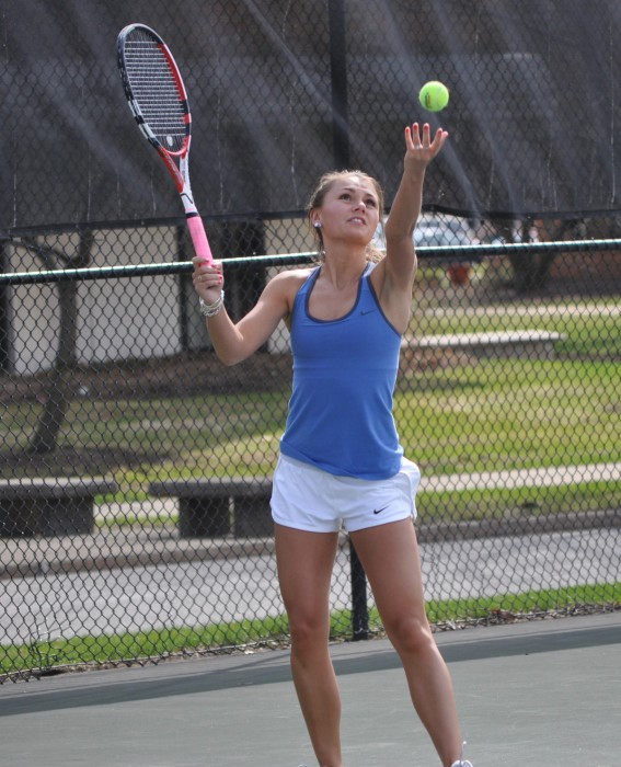 Belles senior Kayle Sexton serves during an 8-1 loss to Hope on April 17, 2014. Sexton is 4-2 over her last six singles matches for the Belles.