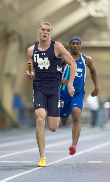 Irish senior Chris Giesting runs a leg of a relay during the Notre Dame Invitational at Loftus Sports Center on Jan. 24.