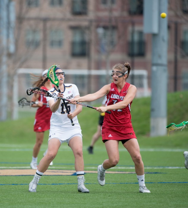 Irish sophomore attack Cortney Fortunato is pressured while passing during a 10-8 loss to Louisville at Arlotta Stadium on April 19.