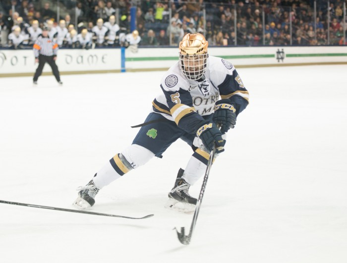 Irish senior defenseman Robbie Russo tries to corral a loose puck in the offensive zone in Notre Dame's 3-3 tie with Connecticut on Jan. 16.