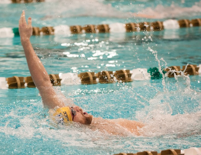 Notre Dame senior Jonathon Williamson competes in the backstroke during a meet against Cleveland State on Feb. 7 at Rolf's Aquatic Center.