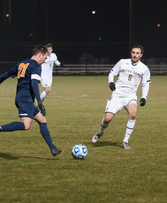 Senior Irish defender Max Lachowecki marks his opponent in Notre Dame's 1-0 loss to Virginia in the third round of the NCAA Championships on November 30.
