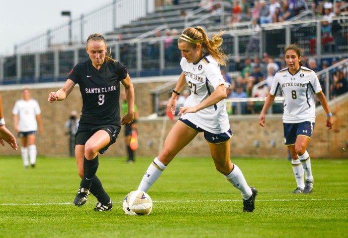 Irish junior forward Kaleigh Olmsted navigates the Santa Clara defense during Notre Dame's 2-1 win Friday night at Alumni Stadium. Olmsted scored the 36th-minute equalizer against the Broncos.