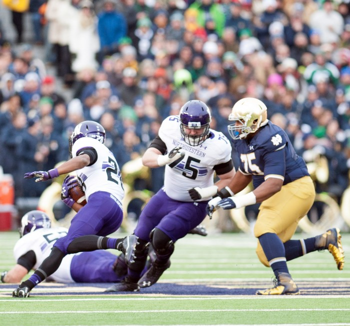 Irish sophomore defensive lineman Daniel Cage pursues Northwestern sophomore running back Justin Jackson during Notre Dame's 43-40 loss to Northwestern at Notre Dame Stadium on Nov. 11.