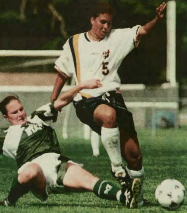 Midfielder Shannon Boxx hurdles over a slide tackle during Notre Dame's 6-0 win over Michigan State on Aug. 31, 1997. Boxx finished her Irish career with 39 goals and 57 assists.