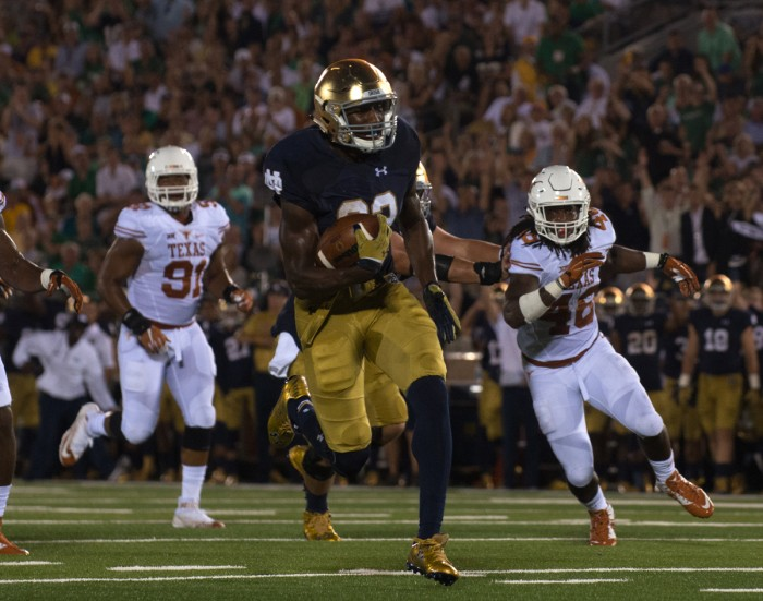 Freshman running back Josh Adams carries the ball during Notre Dame's 38-3 victory over Texas on Sept. 5 at Notre Dame Stadium.