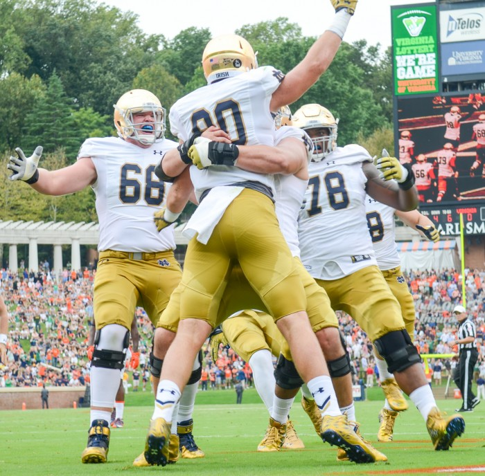 Notre Dame junior tight end Durhma Smythe celebrates after a score during Saturday's 34-27 win over Virginia at Scott Stadium.