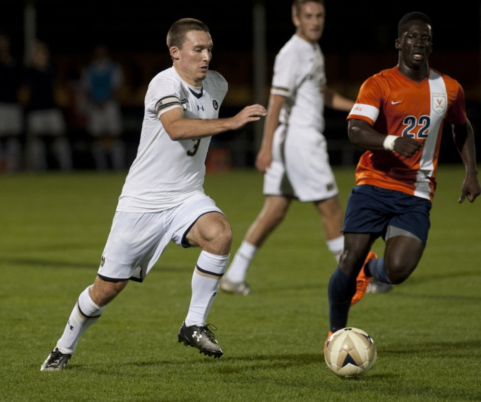 Senior midfielder Connor Klekota dribbles past a defender during Notre Dame's 3-1 victory over University of Virginia on Friday.