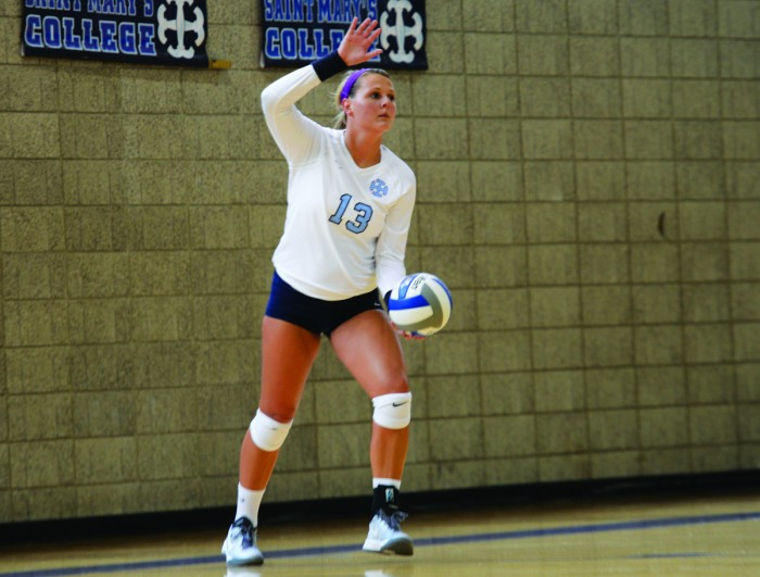 Saint Mary's junior outside hitter Meaghan Gibbons readies to serve during the Belles'  3-0 win in their home opener against Manchester.