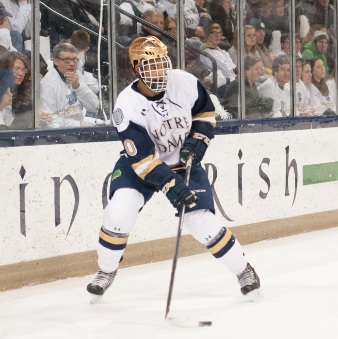 Junior defenseman Justin Wade surveys the ice during a  2-0 loss to Boston College on Feb. 27 at Compton Family Ice Arena.