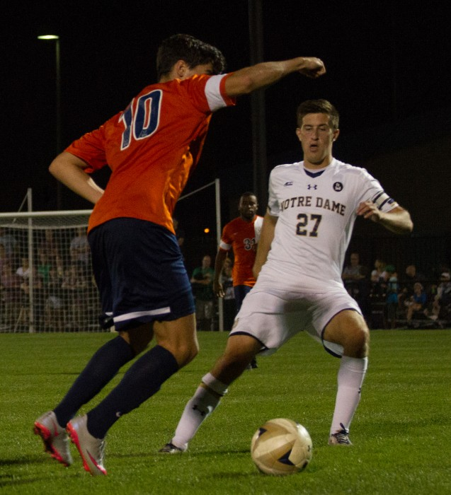 Senior midfielder Patrick Hodan makes a move on a defender during a 3-1 win over Virginia on Sept. 25 at Alumni Stadium.