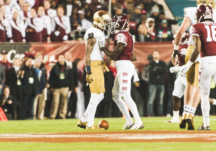 Irish junior receiver Will Fuller and Temple senior defensive back Tavon Young exchange words.