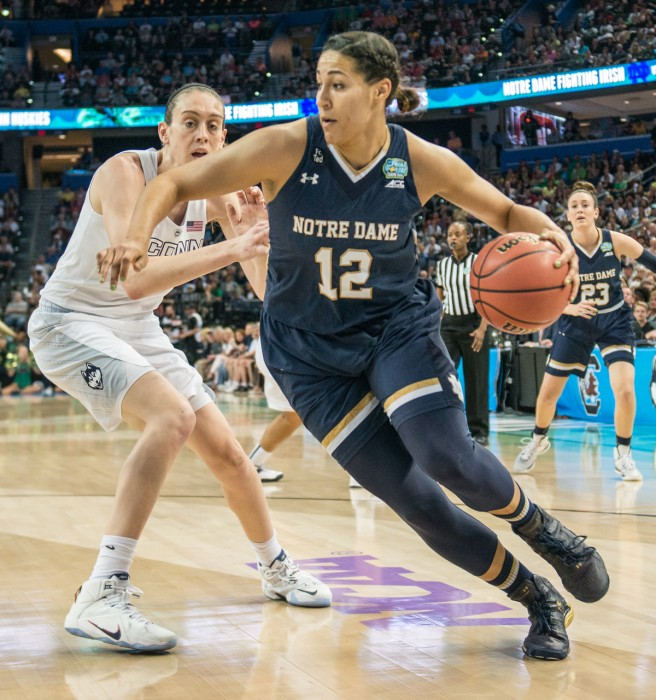 unior forward Taya Reimer dribbles around Breanna Stewart in Notre Dame's 63-53 loss to  Connecticut on April 7 in the national championship game at Amalie Arena in Tampa, Florida