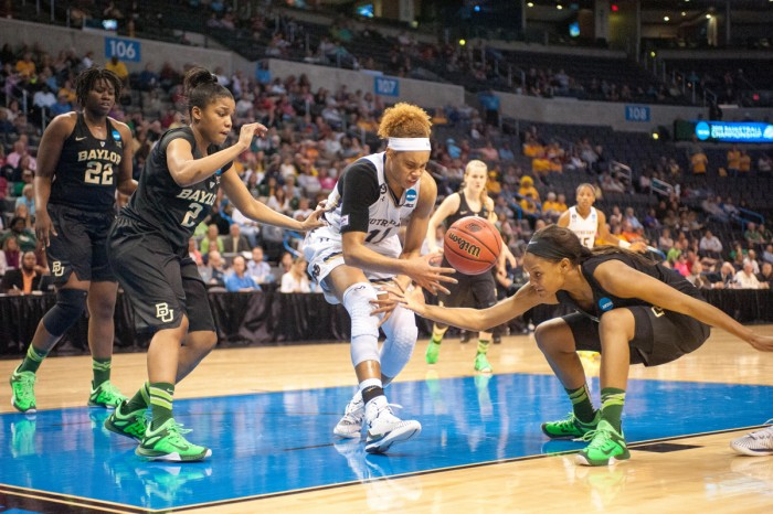 Sophomore forward Brianna Turner tries to gain control of the       basketball during Notre Dame's 77-68 win over Baylor on March 29.