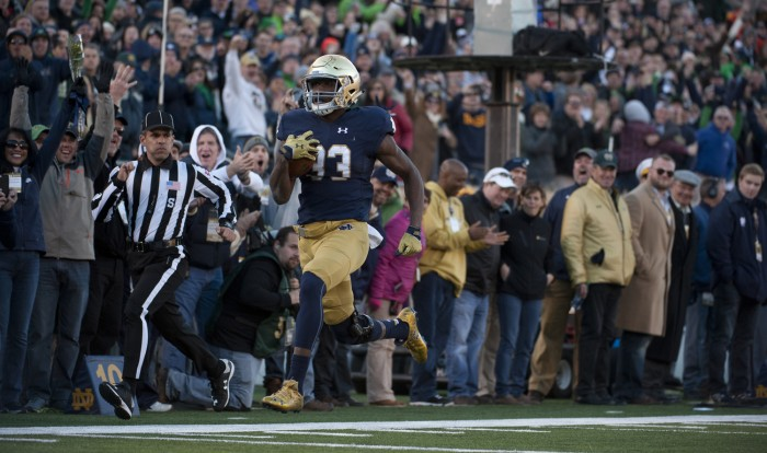 Irish freshman running back Josh Adams dashes for the end zone at the end of his 98-yard touchdown run in Notre Dame's 28-7 win over Wake Forest on Saturday at Notre Dame Stadium.  Adams' run, in his first career start, was the longest play from scrimmage in Notre Dame history, breaking Blair Kiel and Joe Howard's 34-year-old record.