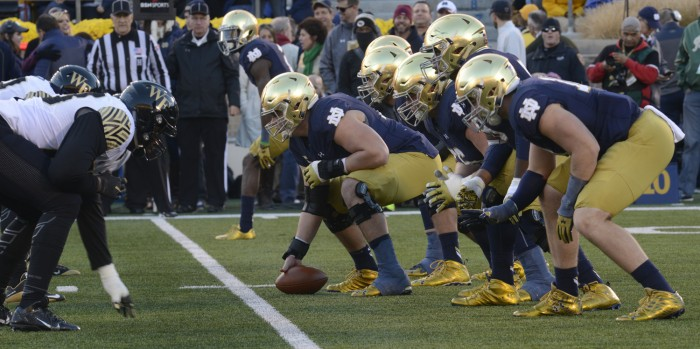 Graduate student center Nick Martin prepares to snap the ball during Notre Dame's 28-7 win over Wake Forest on Saturday. Martin, a two-time captain, has helped lead the Irish to a 9-1 record this year.