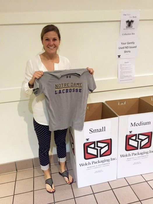 Senior Katherine McManus donates issued lacrosse gear in North Dining Hall for the One Shirt, One Body initiative.