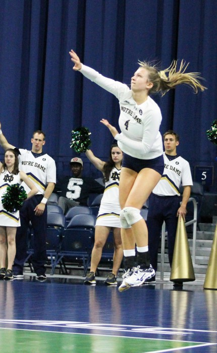 Irish freshman libero Ryann DeJarld serves to start a rally during Notre Dame's 3-2 loss to Syracuse on Oct. 4 at Purcell Pavilion. DeJarld had a match-high 28 digs in the loss.