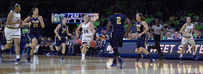 Irish senior guard Hannah Huffman, center, leads a fast break with junior forward Kristina Nelson, left, and freshman guard Marina Mabrey, right, during Notre Dame's 74-39 win over Toledo on Nov. 18 at Purcell Pavilion. Huffman had a team-high seven rebounds, while Mabrey scored six points and Nelson added four points in the win.
