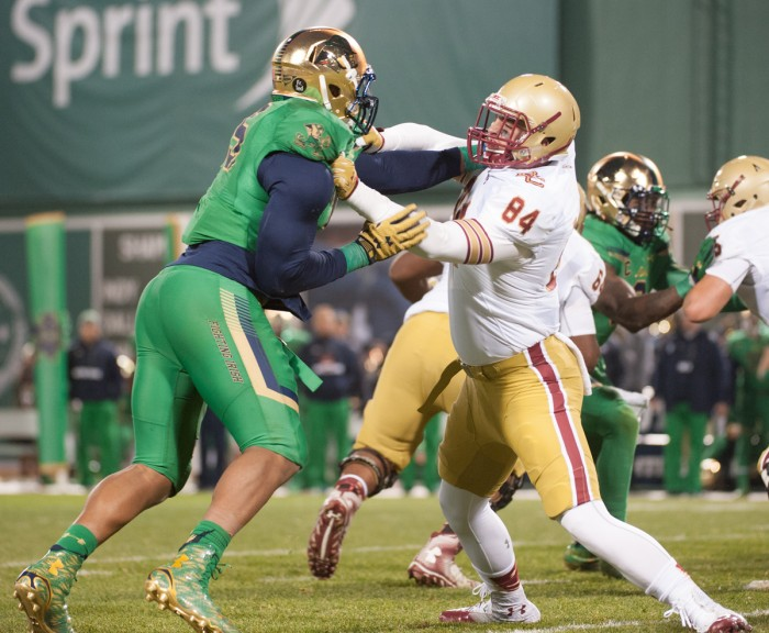 Senior defenselineman Romeo Okwara holds off a Boston College player during Notre Dame's 19-13 victory at Fenway Park.