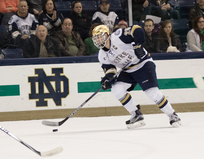 Senior center Steven Fogarty controls the puck during Notre Dame's 3-1 victory over Massachusetts on Friday at Compton Family Ice Arena. Fogarty scored one goal in the win.