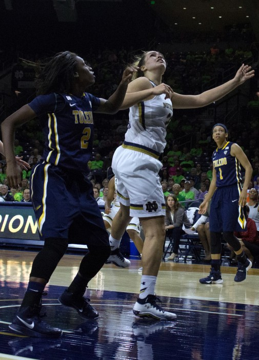 Irish sophomore forward Kathryn Westbeld jostles for position with a Toledo player during Notre Dame's 74-39 win over the Rockets on Nov. 18 at Purcell Pavilion.