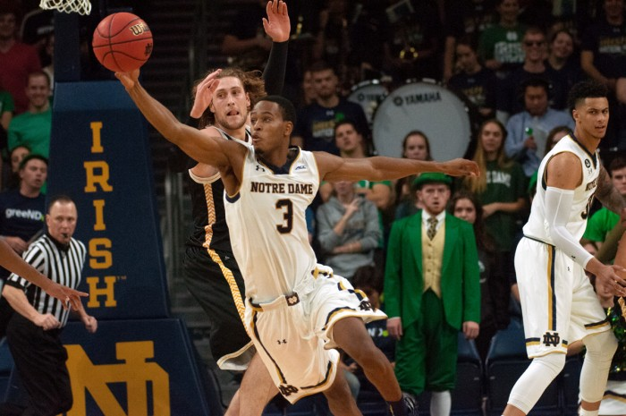 Irish junior forward V.J. Beachem fights for a loose ball during Notre Dame's 86-78 victory over Milwaukee on Nov. 17 at Purcell Pavilion. The Irish return to action against Loyola Chicago on Sunday.
