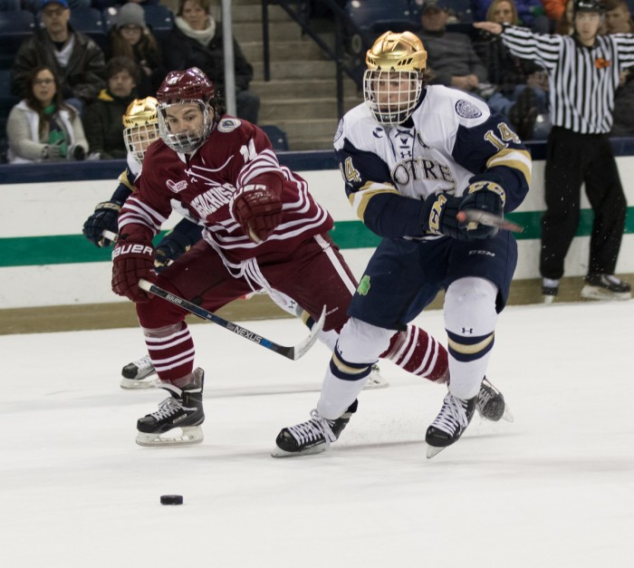 Irish senior center Thomas DiPauli races a UMass defender to the puck during Notre Dame's 5-1 home  victory on Sunday. The Irish will take on Boston College on Thursday in Chestnut Hill, Massachusetts.
