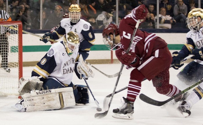 Sophomore goaltender Cal Petersen stops a shot during Notre Dame's 5-1 home conference win over Massachusetts on Dec. 5.