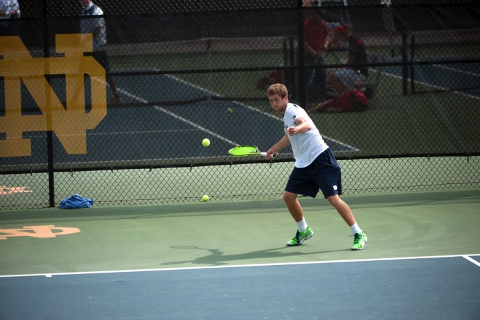 Irish senior Quentin Monaghan attempts a forehand during Notre Dame's 4-3 win over North Carolina State on April 18 at Courtney Tennis Center. Monaghan won his only singles match Saturday.