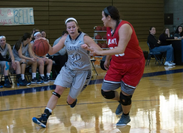 Belles' senior forward and team captain Krista Knapke drives to the basket during a 52-49 loss to Olivet on Jan. 23 at Angela Gym. She scored her 1,000th career point during a loss to Trine on Wednesday.