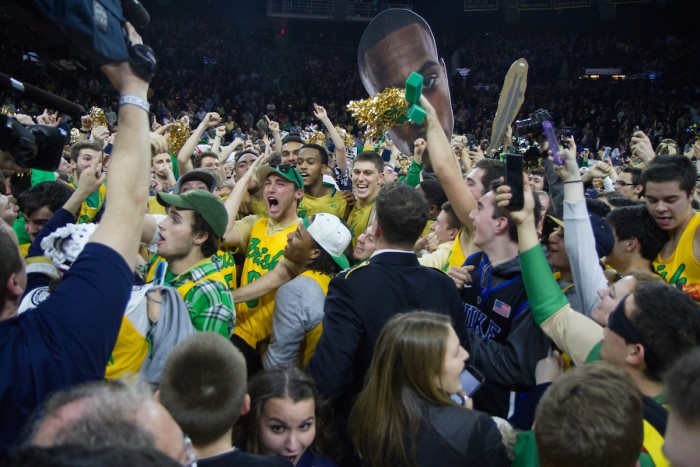 Students celebrate following Notre Dame's 80-76 win over No. 2 North Carolina on Saturday night at Purcell Pavilion.