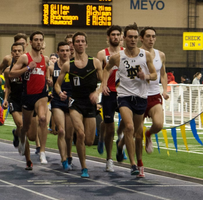 Senior Michael Clevenger leads a pack of runners during the 3,000-meter run at Loftus Sports Center on Saturday afternoon. Clevenger finished the event with a time of 18:15.56.