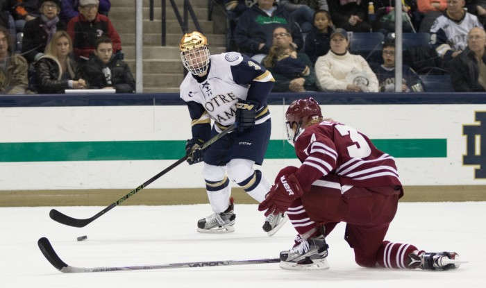 Sophomore defenseman Jordan Gross looks to make a pass during Notre Dame's 5-1 victory over Massachusetts on Dec. 5. Gross was named the Hockey East Defensive Player of the Week for his four-point performance during the weekend series against Vermont.
