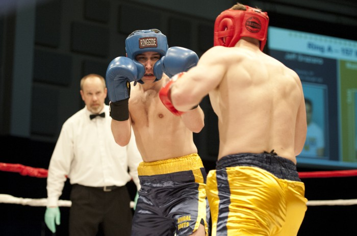 Junior Chip Blood, right, throws a punch during his bout with graduate student Sam O'Brien during Sunday's Bengal Bouts action at the JACC.
