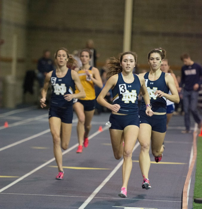 Irish senior Danielle Aragon, center, leads a pack of runners during the Blue & Gold Invitational on Dec. 5, 2014, at Loftus Sports Center. Aragon will compete in the distance medley relay Saturday.