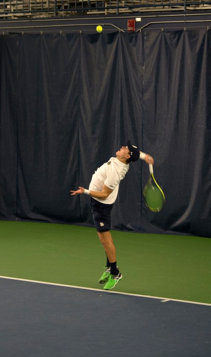 Irish sophomore Brendon Kempin serves during Notre Dame's 7-0 victory over Ball State on Feb. at Eck Tennis Pavilion.