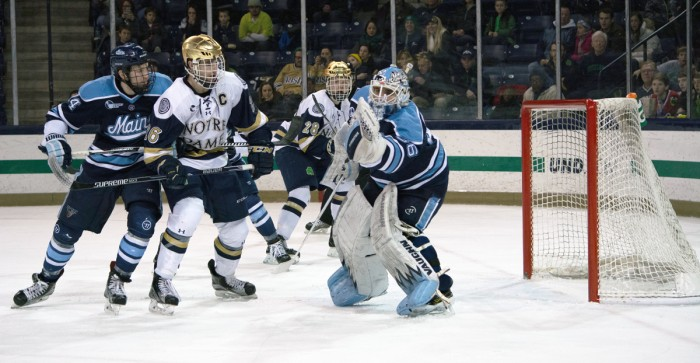 Irish senior captain Steven Fogarty crashes the net during Notre Dame's 5-1 win over Maine on Feb. 13 at Compton Family Ice Arena.