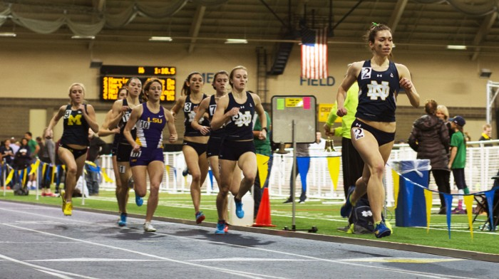 Irish sophomore Jessica Harris, far right, leads a pack of runners during the 800-meter run Saturday. Harris was a part of the distance medley relay  team that posted a qualifying time for nationals at the meet.