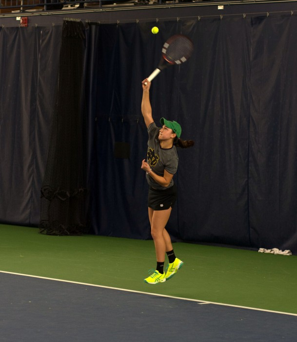 Irish senior Quinn Gleason fires a serve during Notre Dame's 6-1 win over Indiana on Saturday at Eck Tennis Pavilion. Gleason is 13-3 in singles play this season and 8-5 in doubles play.