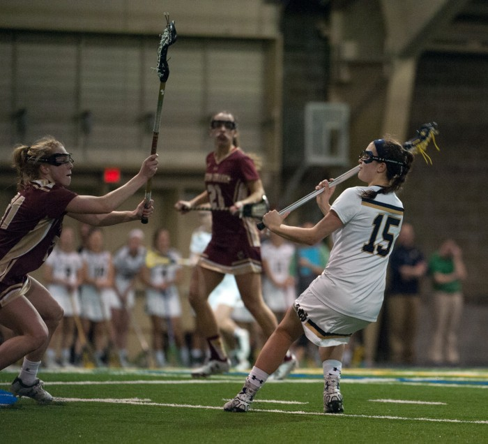 Irish junior attack Cortney Fortunato surveys her options during Notre Dame's 14-4 win over Boston College on Saturday.