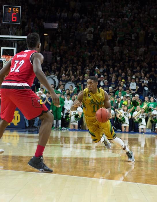 Irish junior guard Demetrius Jackson dribbles around a defender during Notre Dame's 71-66 win over Louisville on Feb.