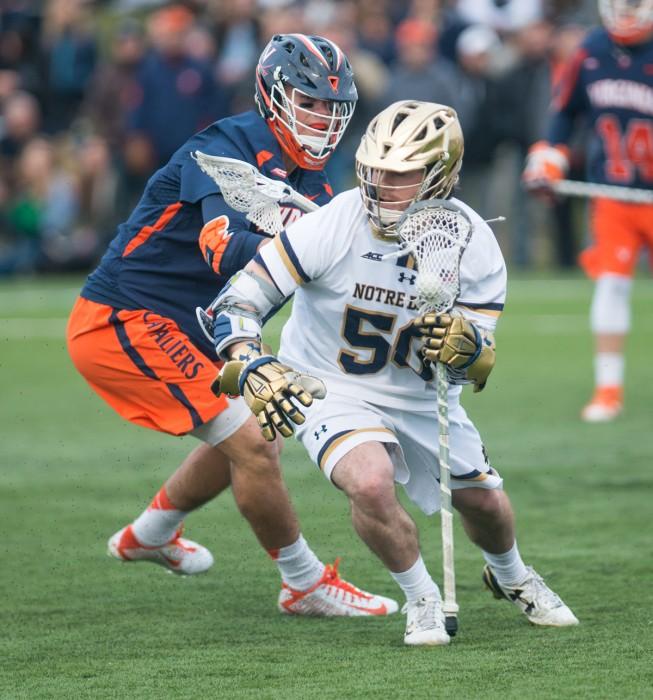 Senior attack Matt Kavanagh shields a defender during Notre Dame's  8-7 overtime victory over Virginia on March 19 at Arlotta Stadium.