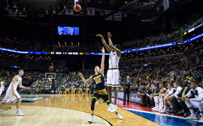Junior forward V.J. Beachem hits a 3-pointer during Notre Dame's 70-63 win over Michigan on Friday in Brooklyn, New York.