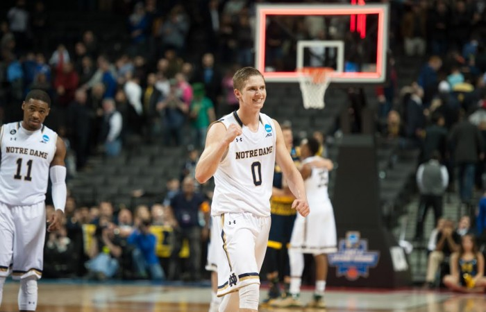 Freshman guard Rex Pflueger celebrates following Notre Dame's 70-63 win over Michigan on Friday in Brooklyn, New York.